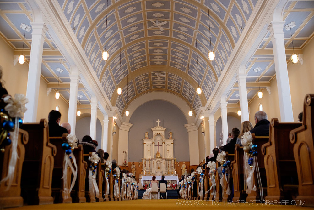 A wide angle photograph from the back of the church during a wedding ceremony in North Bay, Ontario.