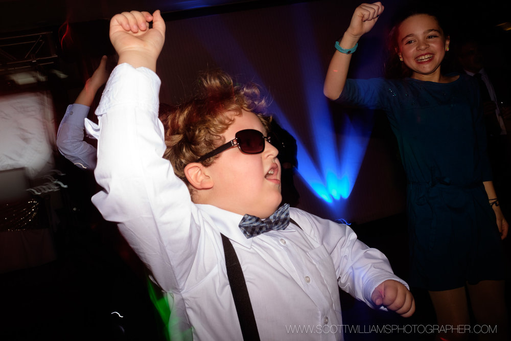 Kids party it up on the dance floor during the wedding reception in North Bay, Ontario.