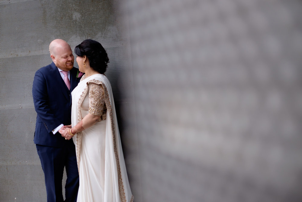 Noor and John pose for a wedding portrait on the streets of Toronto before their wedding ceremony at the Toronto Reference Library.