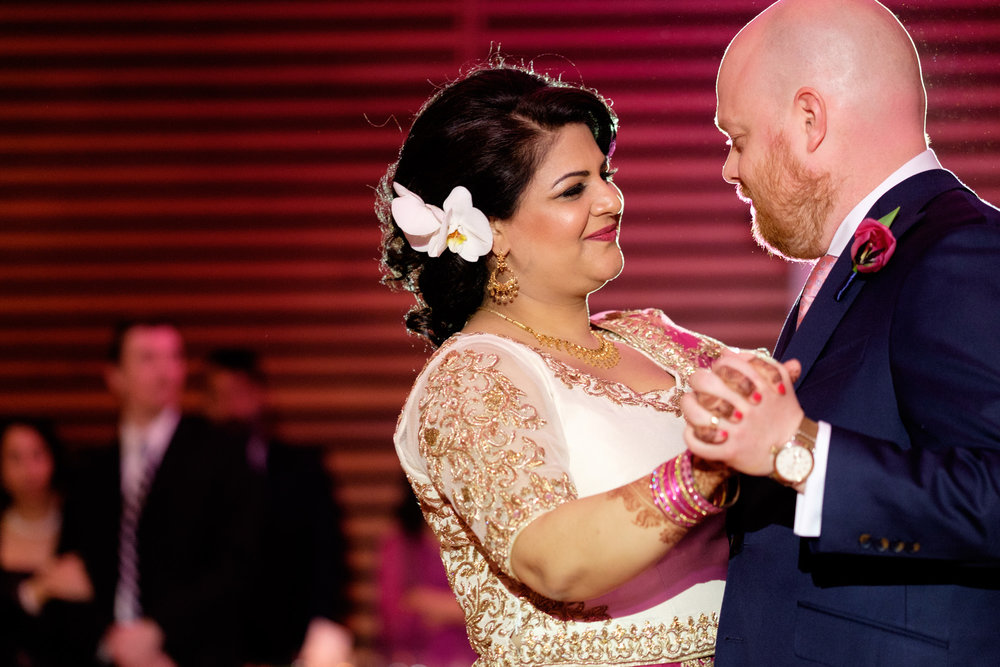 Noor and John enjoy their first dance as a married couple during their reception at the Toronto Reference Library.
