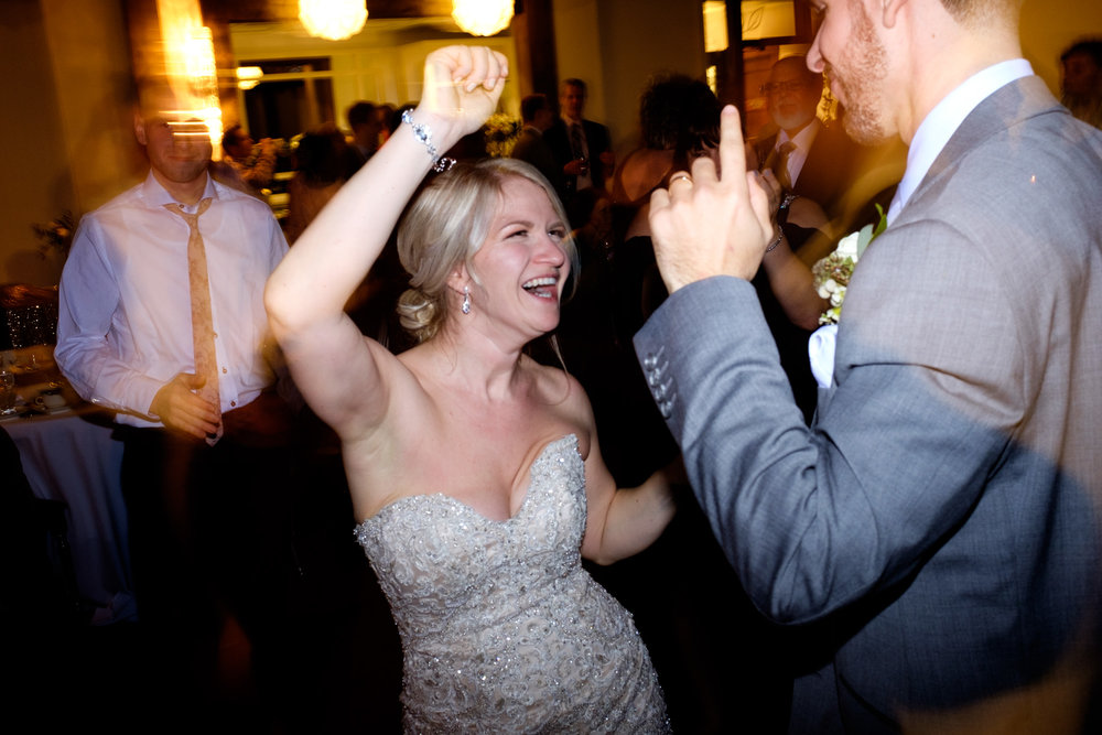 Sarah and Rob party it up on the dance floor during their reception at Whistle Bear in Cambridge, Ontario.
