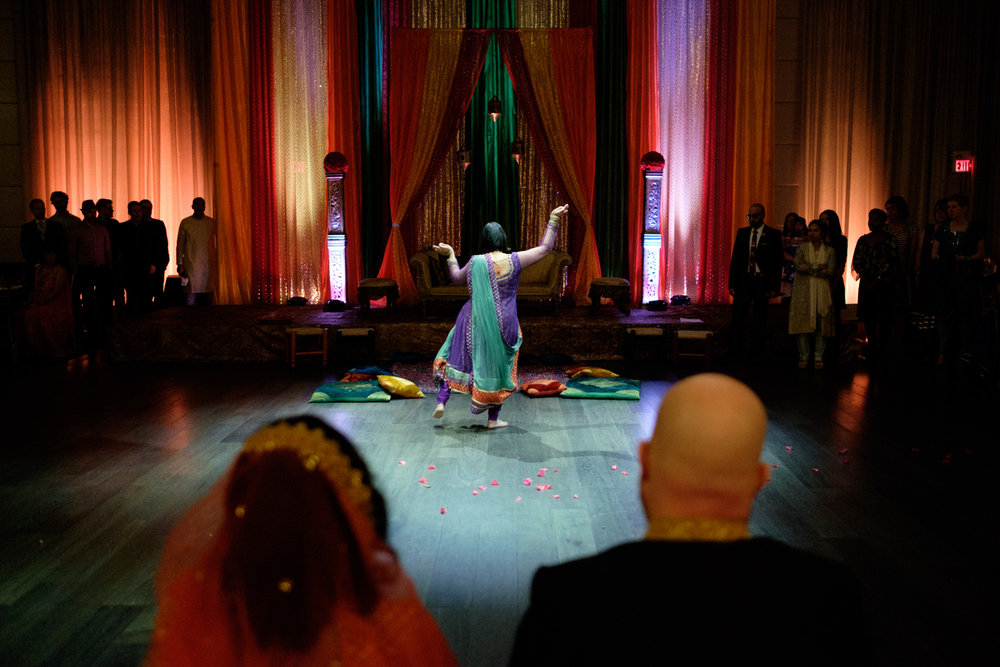 A dancer performs during Noor + John's mehndi ceremony at the Grand Luxe Event Boutique in Toronto.