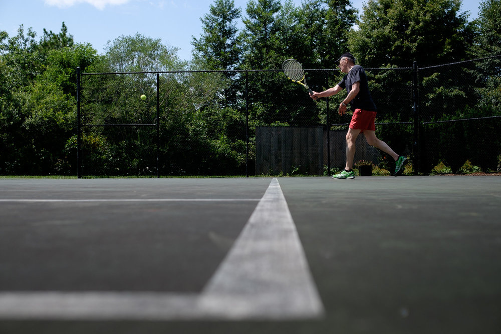 Robert enjoys a game of tennis before his wedding ceremony at Langdon Hall in Cambridge, Ontario by Scott Williams.