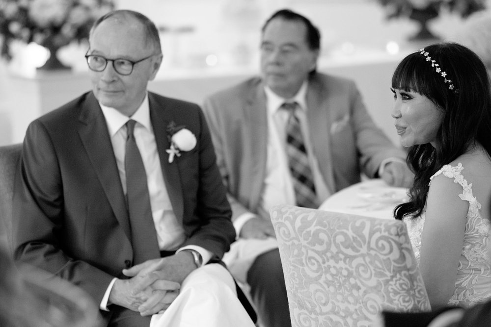 Robert and Teresa listen from their seats as his daughter toasts them during their wedding reception at Langdon Hall in Cambridge, Ontario.  Photo by Scott Williams.