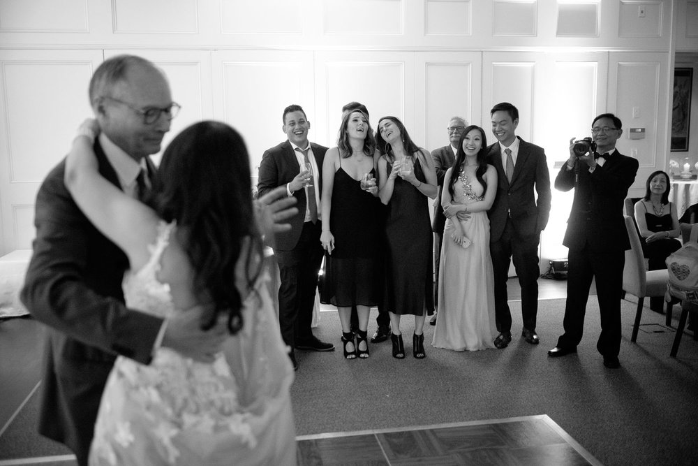 Friends and family look (and sing) along as Teresa + Robert enjoy their first dance as a newly married couple during their wedding reception at Langdon Hall in Cambridge, Ontario.