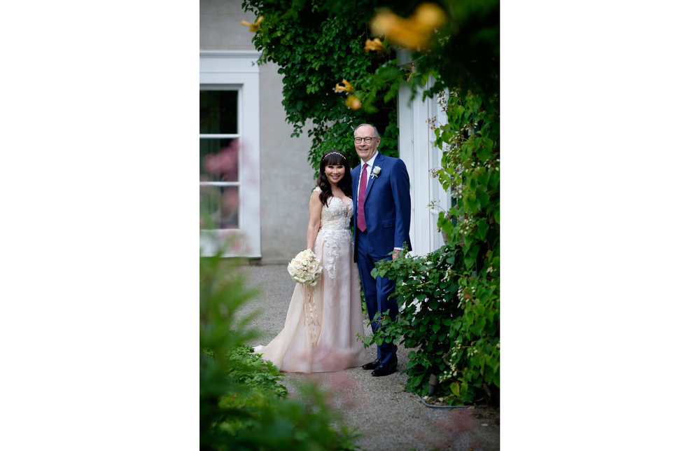 A wedding portrait of Teresa & Robert in the gardens of Langdon Hall in Cambridge, Ontario by Scott Williams.