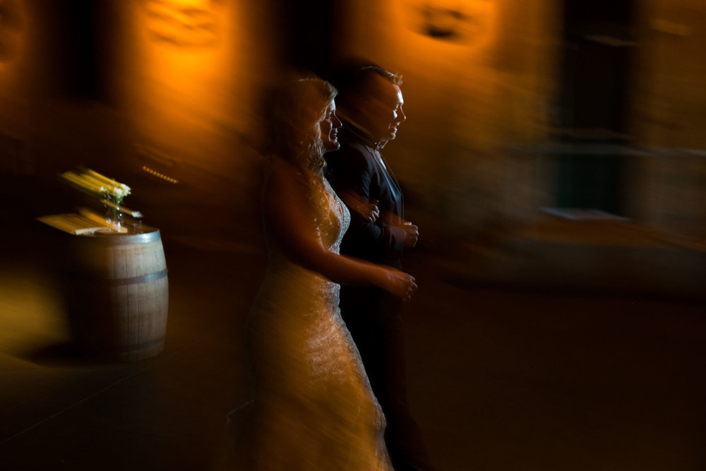 Sarah and Konrad make their entrance during their wedding reception at the Fermenting Cellar in Toronto.