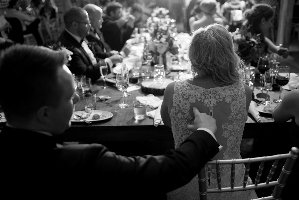 A moment during the wedding reception at the Fermenting Cellar in Toronto's Distillery District.