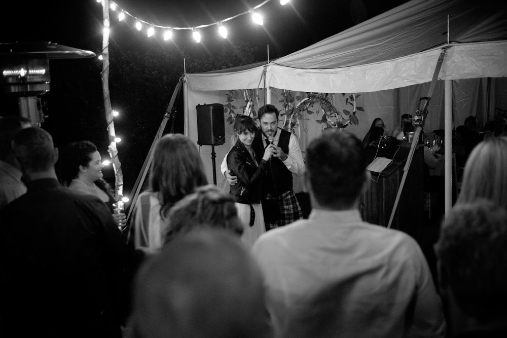 Kristin and Adam give an impromptu wedding speech to their friends and family during their wedding reception in Ontario.  Photograph by Scott Williams.