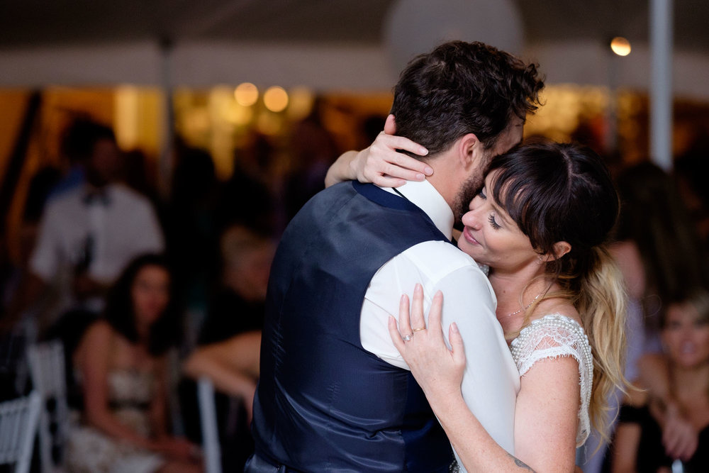Kristin and Adam enjoy their fist dance as a newly married couple during their backyard wedding reception in Barrie, Ontario.  Photograph by Scott Williams.