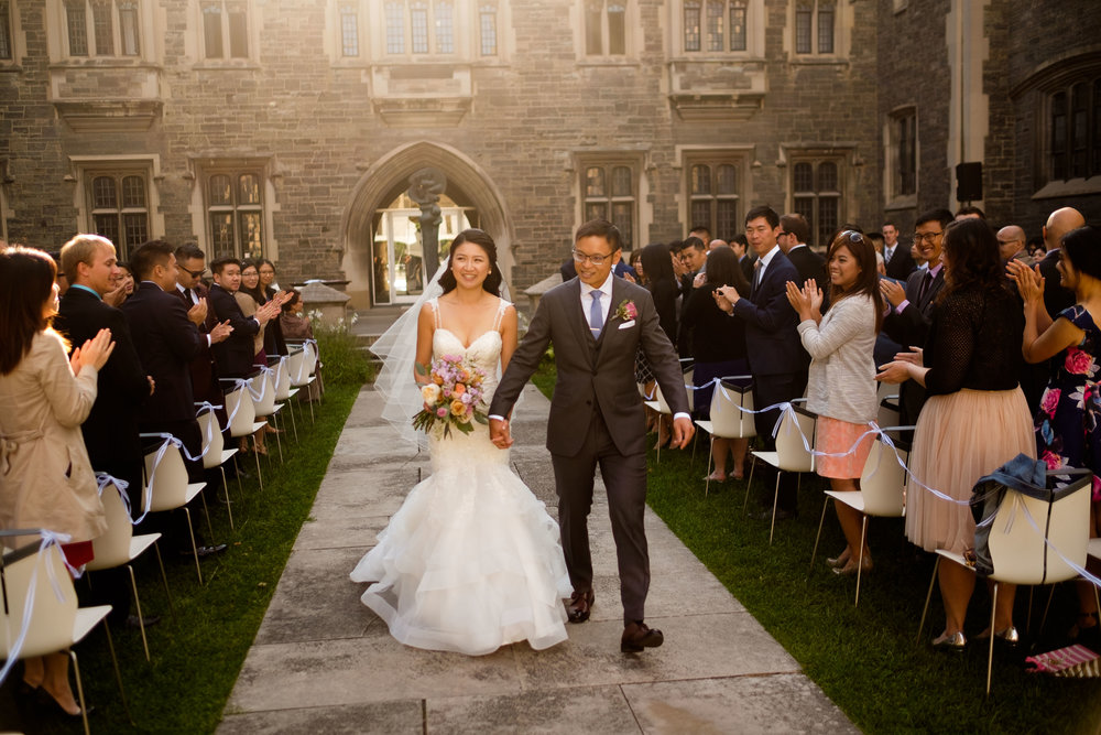 Linda + Andrew walk down the aisle during their outdoor wedding ceremony at the Hart House in Toronto.