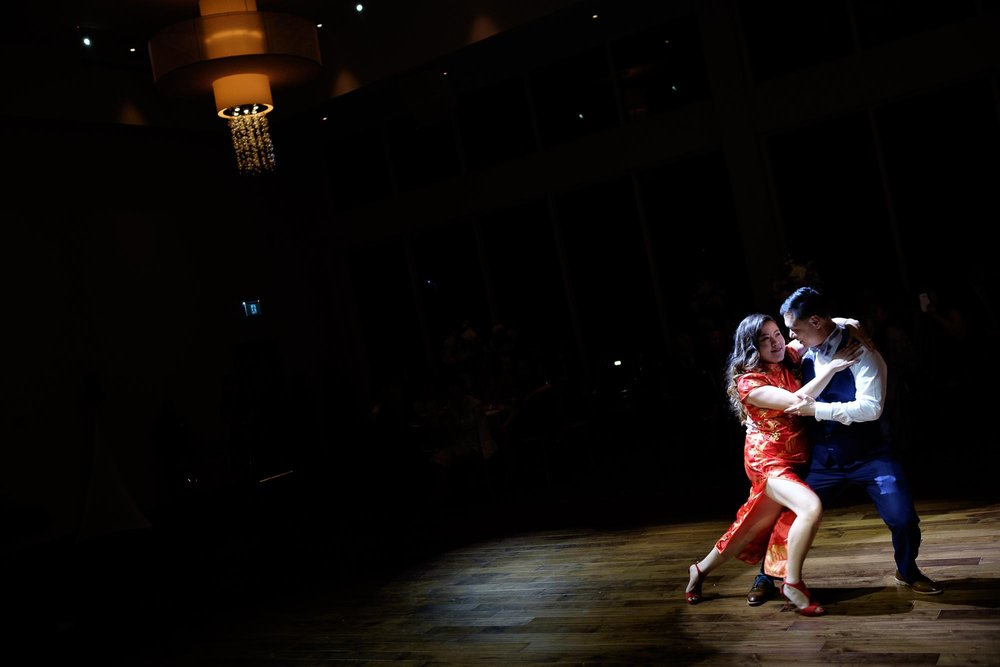 Bride and groom doing a dramatic first dance during their wedding reception at the Guild Inn Estate in Toronto.
