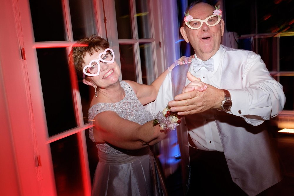 The brides parents dance the night away during the wedding reception at Langdon Hall in Cambridge, Ontario.