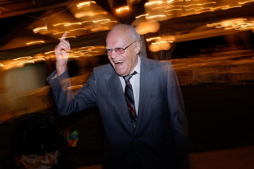 the grandfather hits the dance floor during the wedding reception at the markham museum in Ontario.