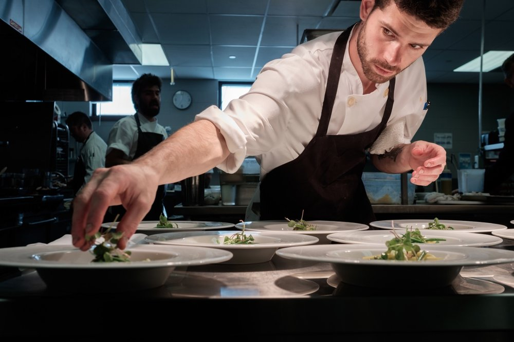 Commercial photograph of a chef in a  kitchen by commercial photographer Scott Williams.