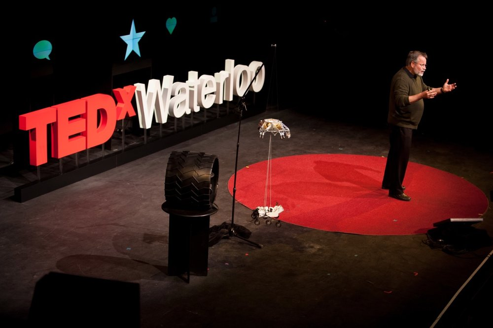 A commercial photograph of a speaker at a TED event in Waterloo by commercial photographer Scott Williams.