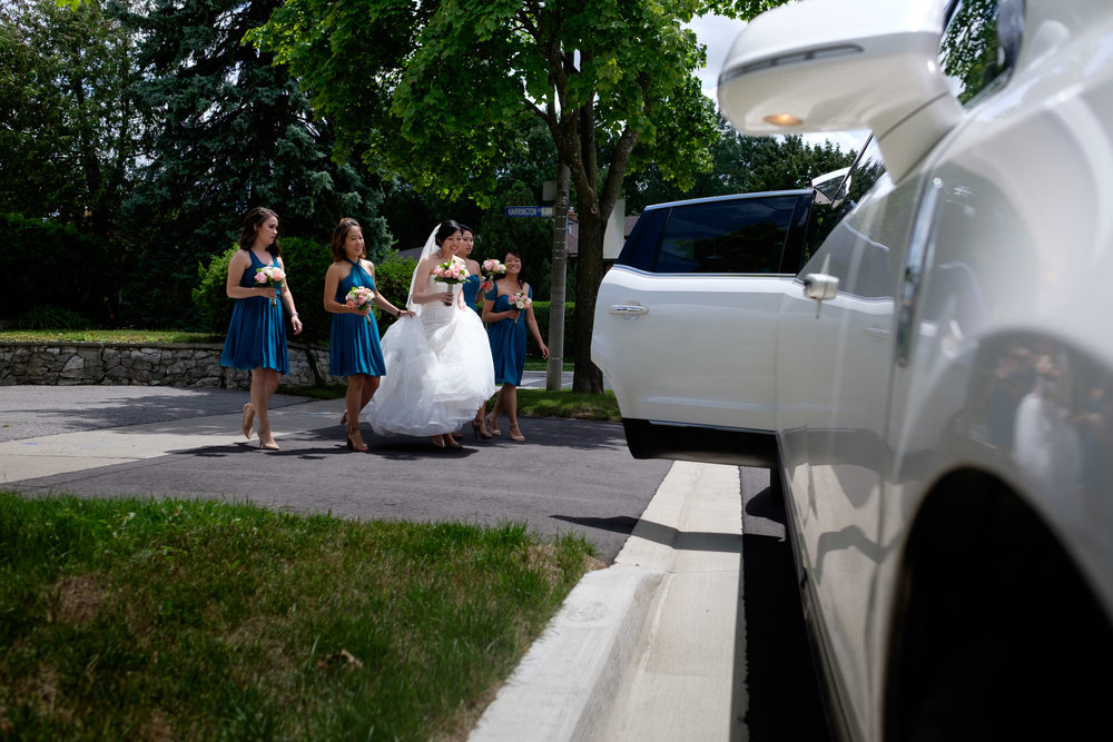 The girls head to the limo to leave for their Roman Catholic wedding ceremony in Toronto.