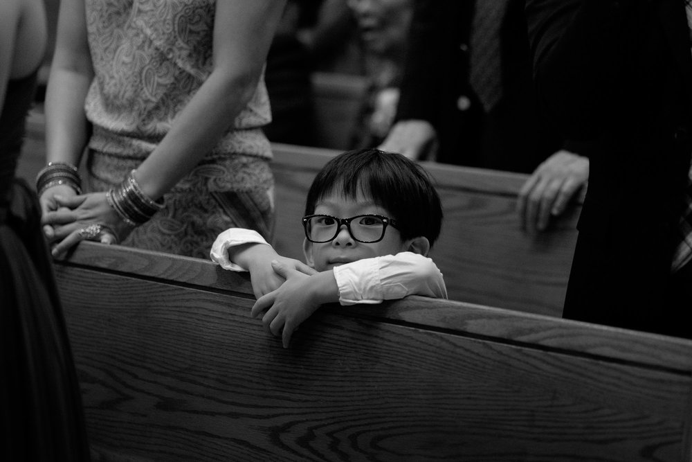 The ring bearer looks on during the wedding ceremony during Chelsea + Danny's wedding in Toronto.