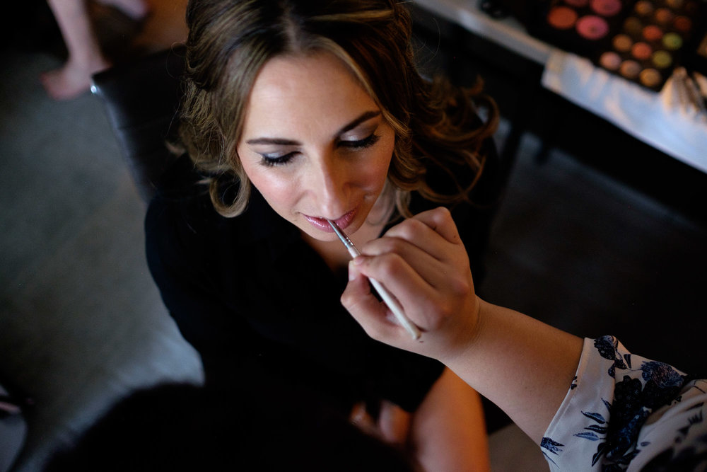 The bride has her make up applied while getting ready for her wedding at the Four Seasons Yorkville.