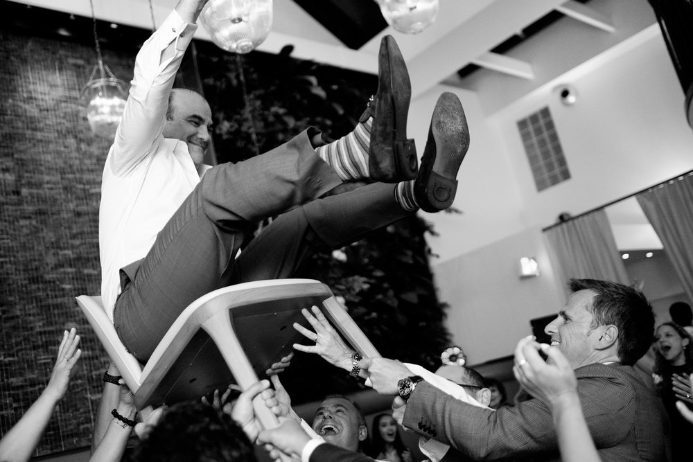 The groom is lifted up during dancing at a Jewish wedding reception in Toronto's Yorkville neighbourhood.