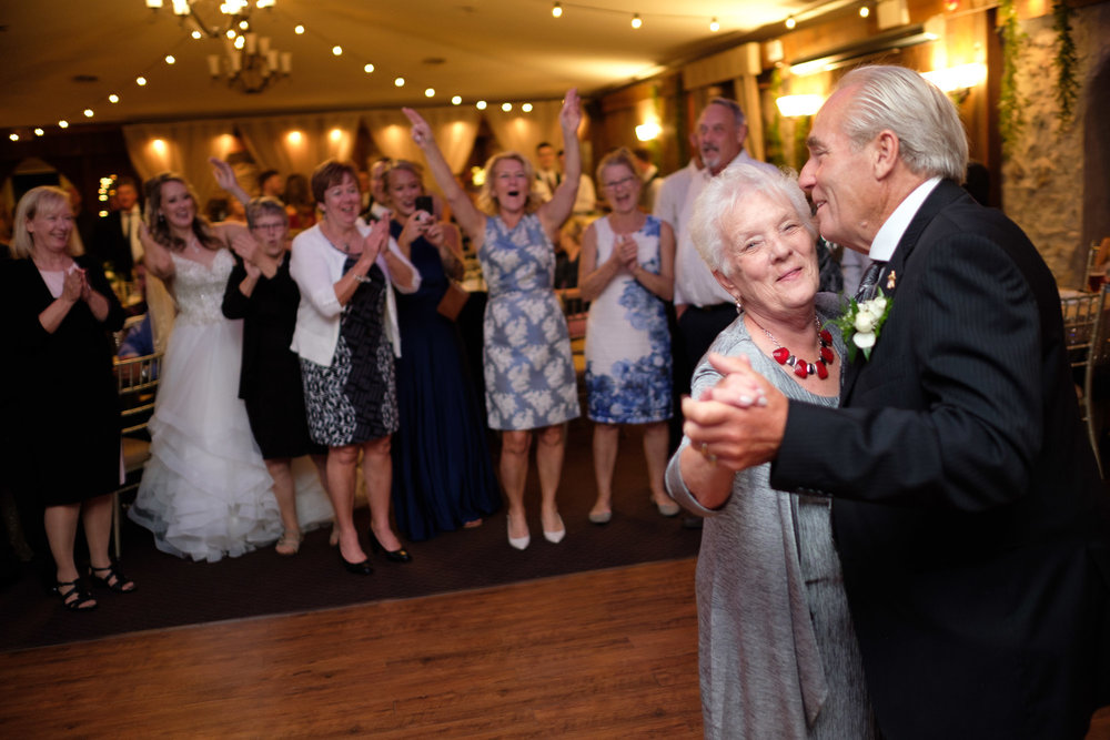 The grandparents of Alex + Colton celebrate their anniversary on the dance floor during the reception at Alex + Colton's wedding at the Hessenland Inn.