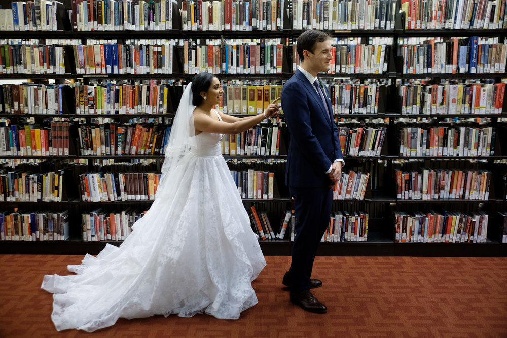 Rob and Andrea enjoy their first look before their new years eve wedding at the Toronto Reference Library.