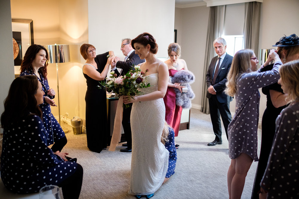 The bridal party gets ready in a suite at the King Edward Hotel in Toronto before leaving for the winter wedding at the Enoch Turner Schoolhouse.