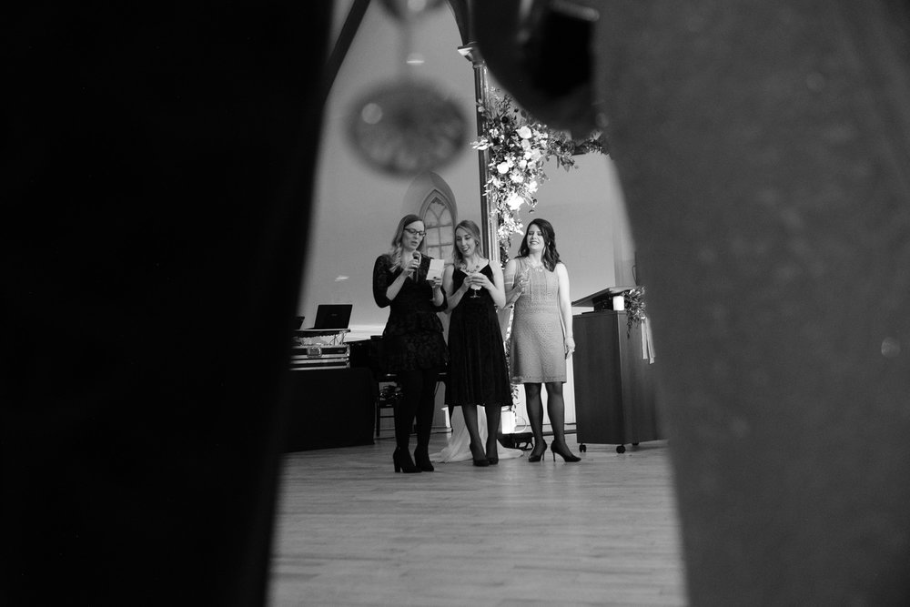 The brides best friends toast the couple during the winter wedding reception at the Enoch Turner Schoolhouse in Toronto.