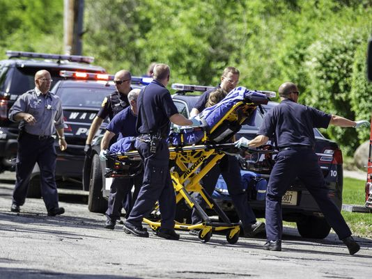 Police and rescue workers act quickly to save the life of a 12-year-old stabbing victim. (Photo: Abe Van Dyke, AP)