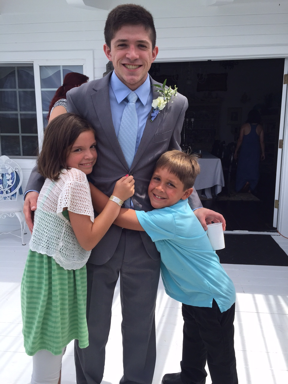 My nephew Steven at the wedding of his brother, Andrew. As you can see, our daughter CJ loves her cousin!