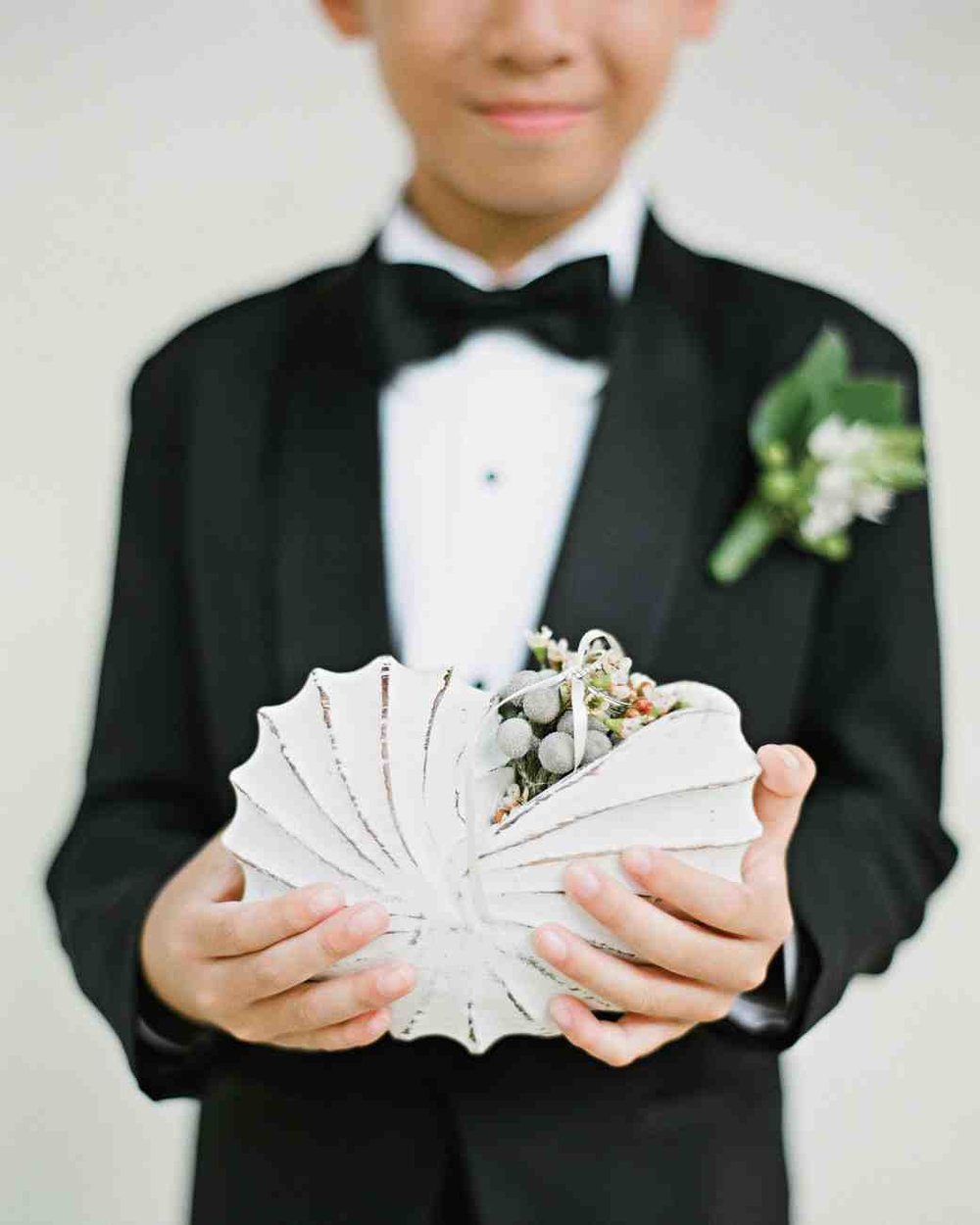 peony-richard-wedding-maldives-ring-bearer-seashell-1402-s112383_vert.jpg