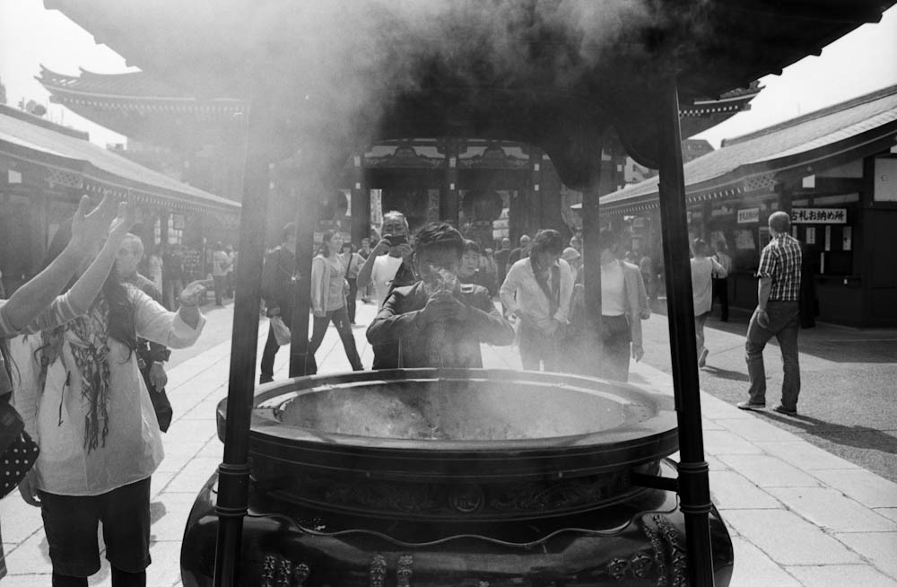 Senso-ji (Asakusa), Tokyo - people would pull the smoke coming from this large incense pot onto themselves as a form of cleansing before entering the temple.