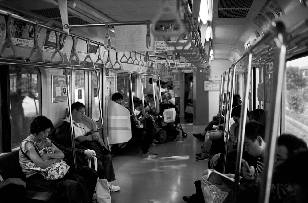 Yamanote Line, Tokyo - people in Japan are exceptionally quiet on the train. It is customary to NOT speak loudly on the train and people keep conversations to themselves.