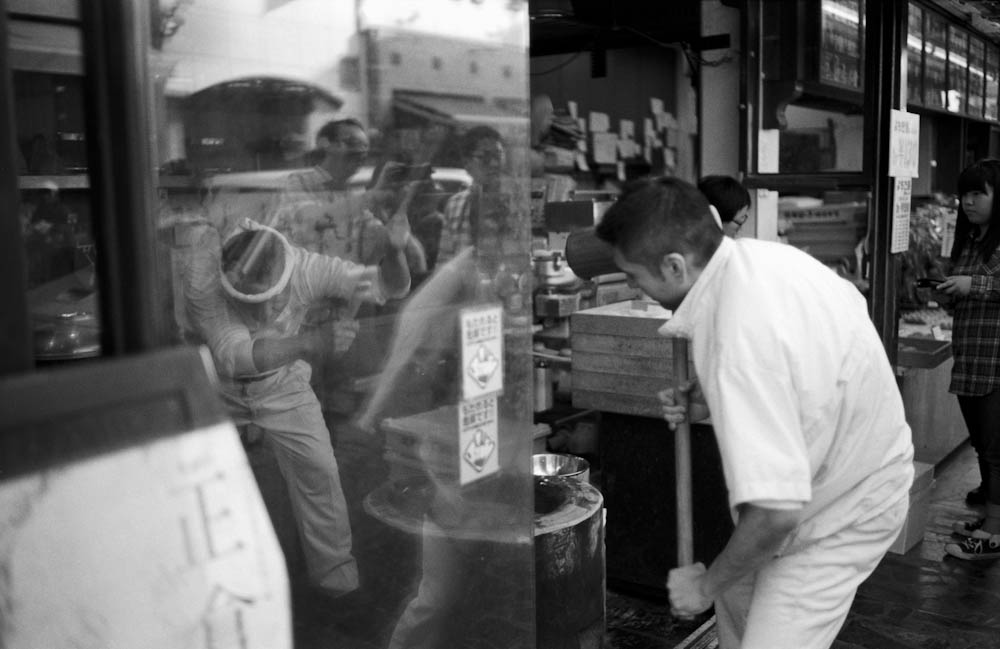 With onlookers like myself looking on, two guys from a shop in Nara pound and create delicious mochi the old-fashioned way.