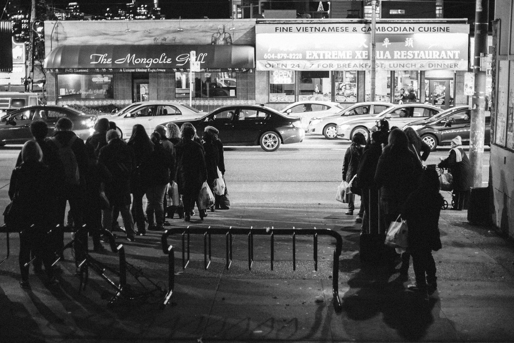 Crowds line up for buses close to the Broadway City Hall Skytrain Station - Taken with the Canon 1D Mk II N and a 50mm F1.4 EF lens.