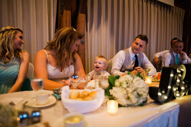 Jeff and Melissa's son laughs during the middle of the reception dinner.
