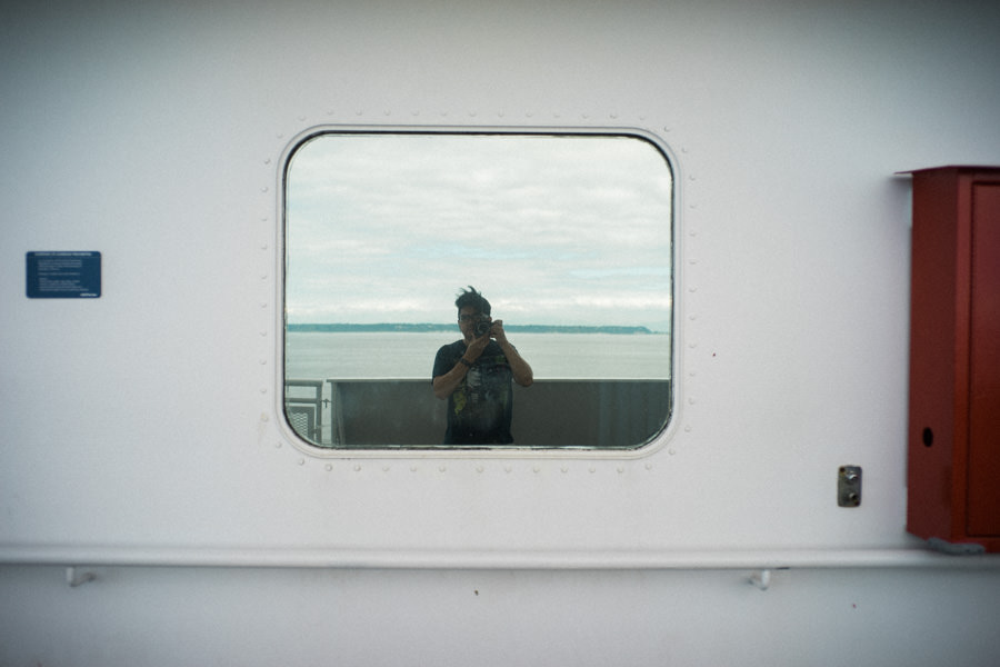 I wonder if there was anyone on the other side of this window thinking it weird that I was taking their picture when I took this photograph of myself :)