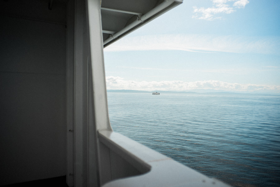"""The passing ferry ship a little further into the distance. Now I understand what people mean by the phrase """"two ships passing in the night""""."""
