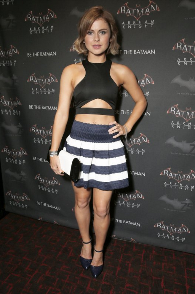 Rose McIver in an AQ/AQ black cropped cut out top and Sans Souci stripe knitted mini dress.
