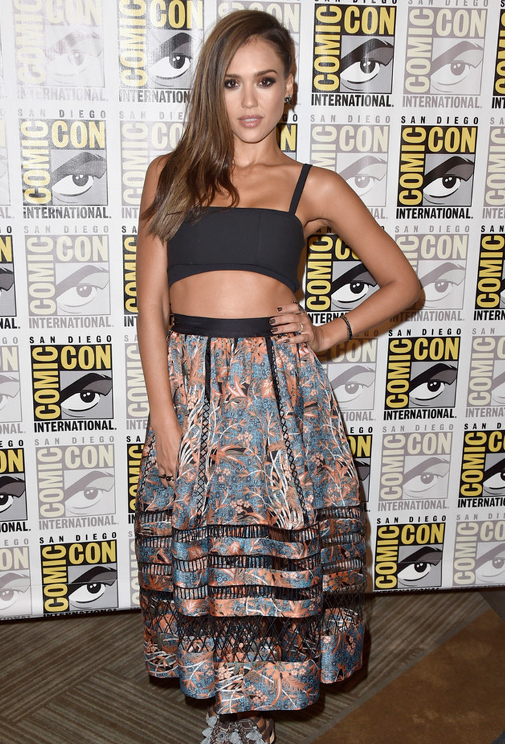 Jessica Alba in a Tanya Taylor crop top and a Zimmerman mesh-panel skirt. I also love her side braid tucking her hair all to one side.