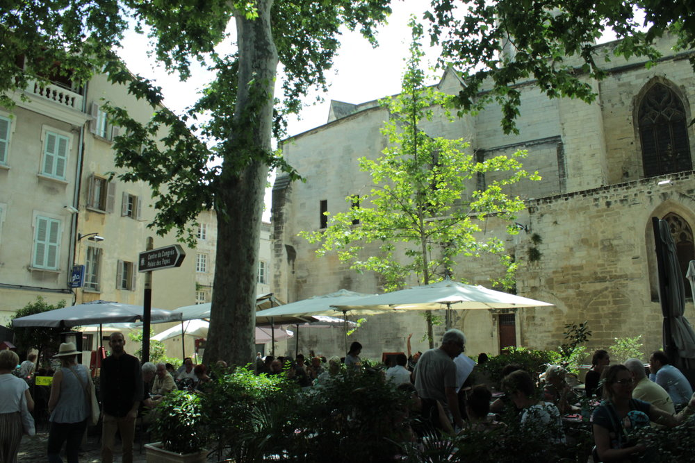 A square behind Avignon's Papal Palace throbs with activity.