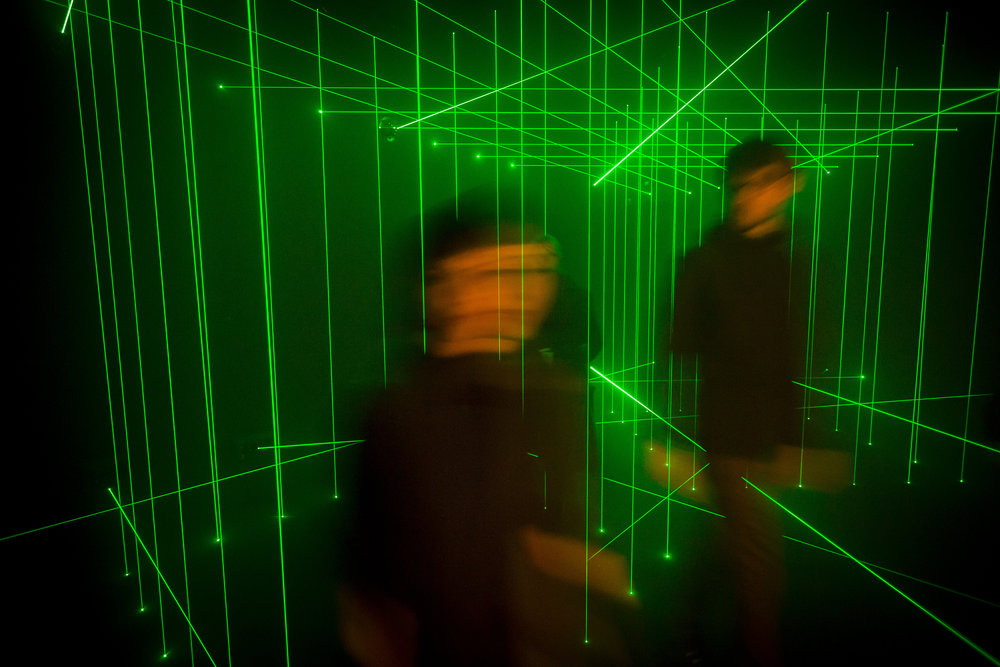 Visitors pass through Li Hui's artwork 'Cage' at White Rabbit Gallery