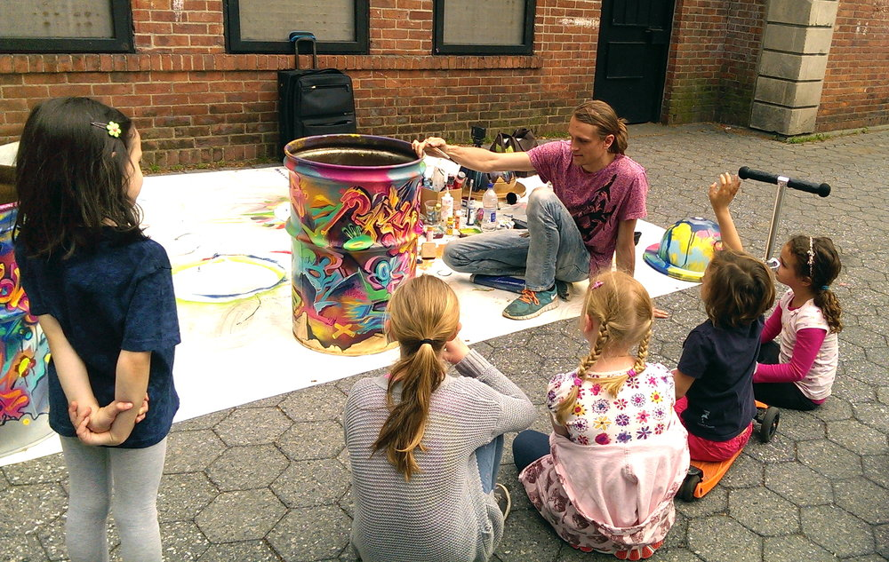 groups of children gathered to watch as i painted trash cans at Carroll Park, Brooklyn