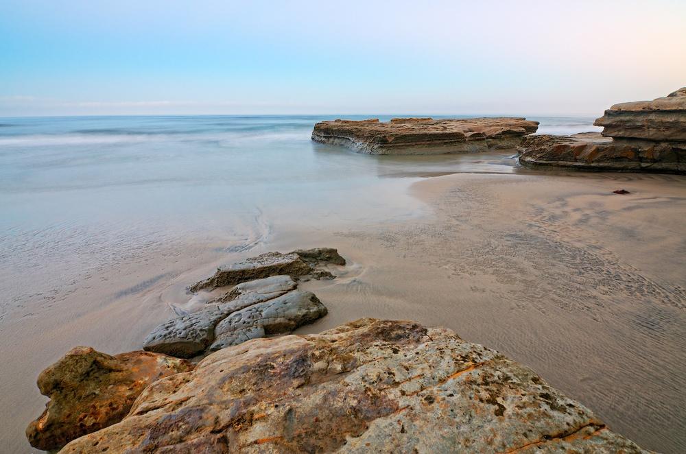 Shot 2 / Camera angled downward toward foreground rocks