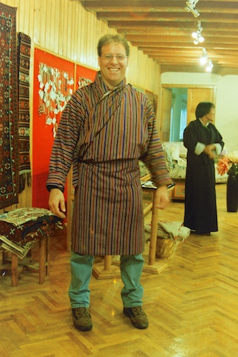 Trying on a Gho in Bhutan