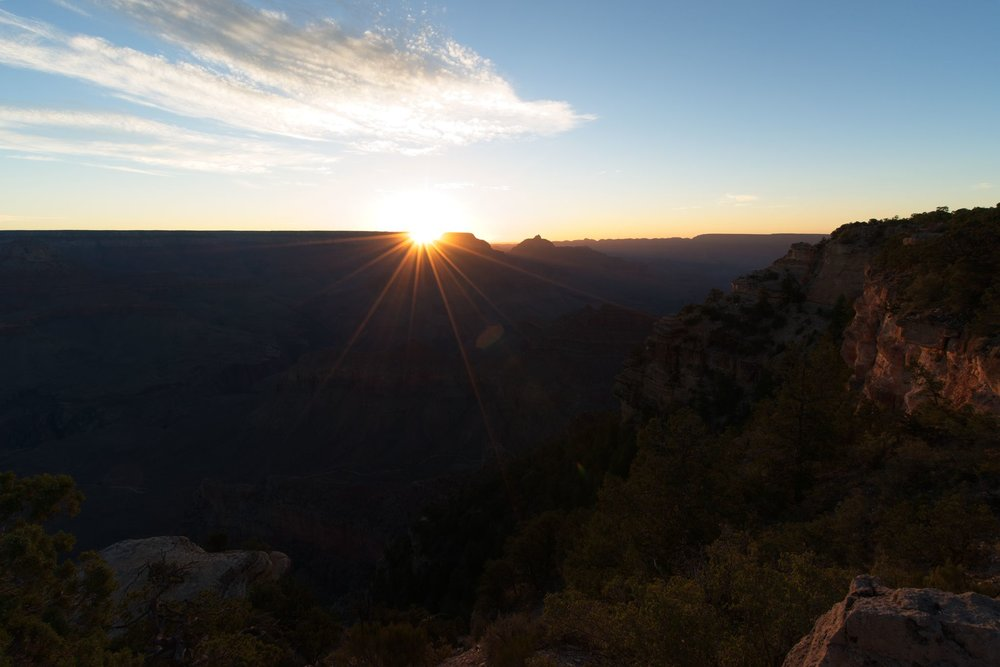 Witnessing sunrise at the Grand Canyon is nothing less than great. The scene continually changes as the morning light creeps downward into the canyon, bathing the rock in golden light.