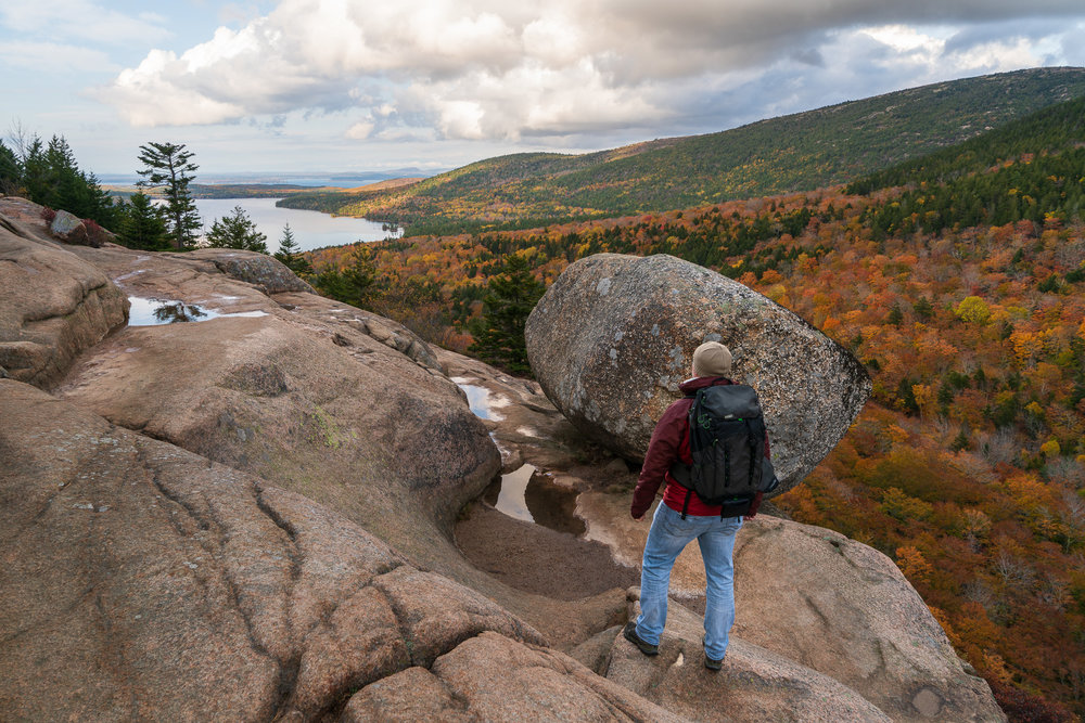 Hiker At Balance Rock In Acadia