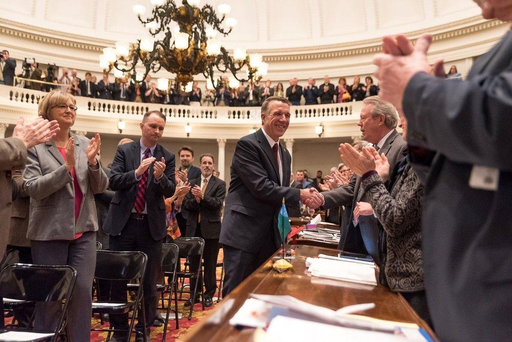 Governor Scott shakes hands with legislator's as he enters to start the legislative session. Photo by Bob LoCicero