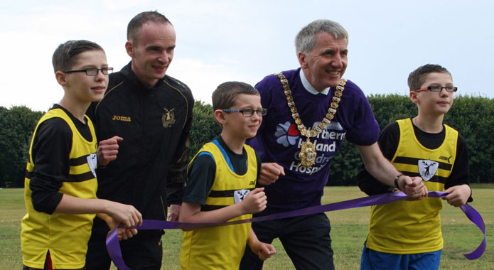 Lord Mayor with North Belfast Harrier coach and junior runners at launch of Laganside 10km (2013) Race