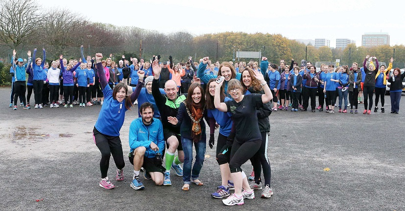 JogBelfast runners just before completing Ormeau Parkrun graduation... with a few coaches, the Lord Mayor and BRC runners photobombing!